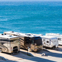 several rvs near a body of water